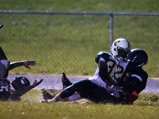 Central's Tommy Abner runs for a touchdown during the