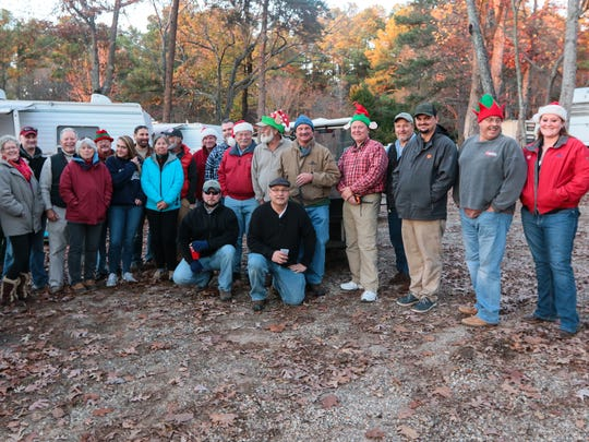 Participants in the Western Carolina Sailing Club 2nd annual Parade of Lights gather for a photo after a brief meeting on Friday, December 9th in Anderson County.