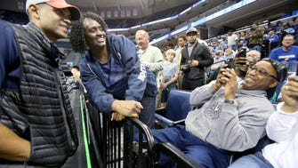Grant Hill poses for a photo with basketball fan Alondray Rogers during the NCAA South Regional open practice Thursday.