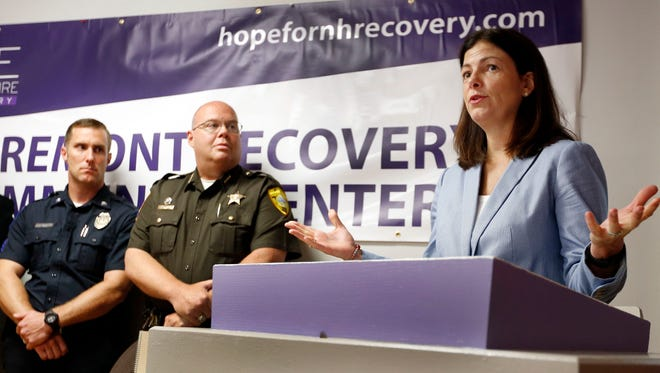 Sen. Kelly Ayotte, R-N.H., speaks at the opening of the HOPE for NH Recovery Center which opened to help fight New Hampshire's opioid crisis Monday, July 18, 2016, in Claremont, N.H. Ayotte is one of many prominent Republicans skipping the convention. (AP Photo/Jim Cole)