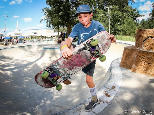 A young skateboarder gets ready for action during a