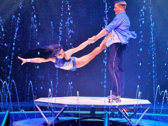 The Zeman Duo roller skating act performs on top of