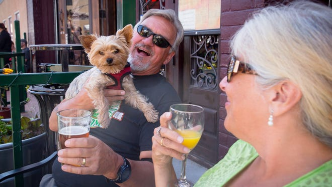 Wallace and Ann Lavery enjoy a drink at the Main St. Bistro & Ale House on Saturday afternoon.