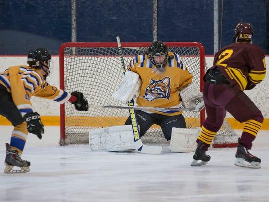 Schoolcraft College goalie Bryan Donaldson  makes one