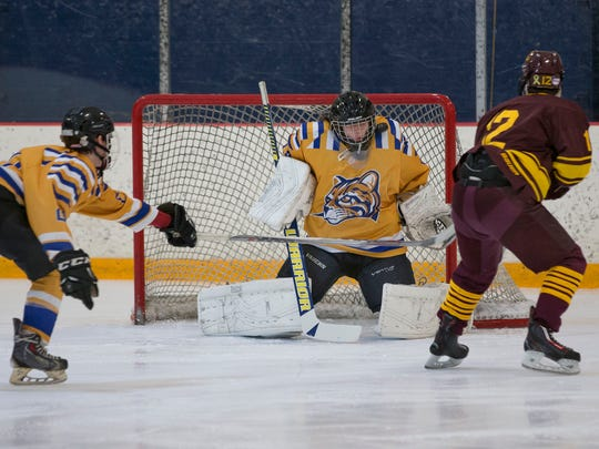 Schoolcraft College goalie Bryan Donaldson  makes one of his 30 stops Saturday night against Central Michigan.