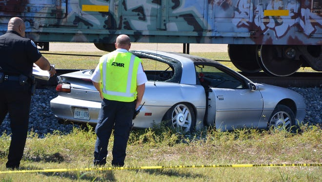 A Chevrolet Camaro and a Kansas City Southern freight train collided along Bullard Street in Jackson Wednesday.