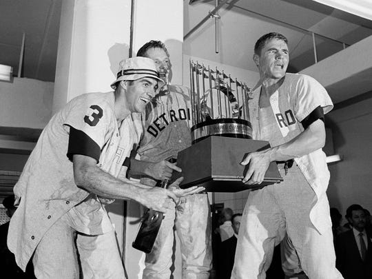 Dick McAuliffe, left, Jim Northrup, center, and Mickey Stanley, with the World Championship trophy Oct. 10, 1968 after defeating the St. Louis Cardinals.