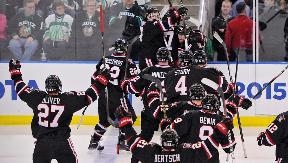 St. Cloud State University players celebrate an overtime