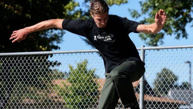 Nick Hauger grinds on a table at Drake Springs Skateboard Park on Thursday, Sept. 7, 2017. Sioux Falls skaters say the time has come to upgrade from the metal ramps used at Drake Springs and Kuehn Park to a concrete park.