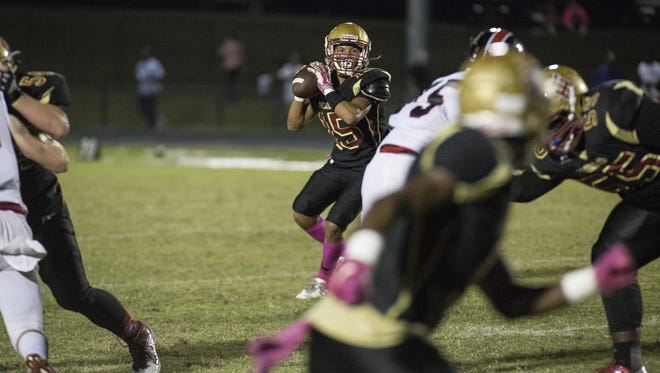 Florida High's Bryson Hill looks for open teammate for a pass against North Florida Christian on Friday night.