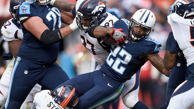 Titans running back Derrick Henry (22) gets stopped by Broncos free safety Darian Stewart (26) in the second quarter at Nissan Stadium Sunday ,Dec. 11, 2016, in Nashville, Tenn.