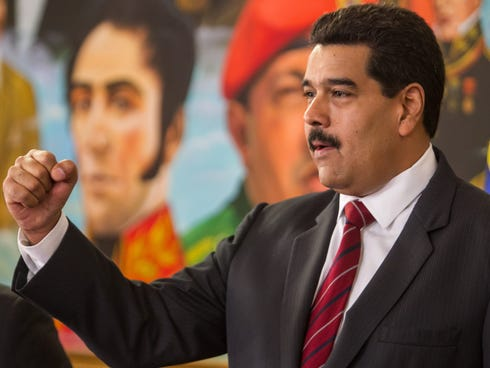 Venezuelan President Nicolas Maduro clenches his fist as he participates in a work meeting with the  Venezuelan National Assembly at the Miraflores Palace in Caracas, Venezuela.