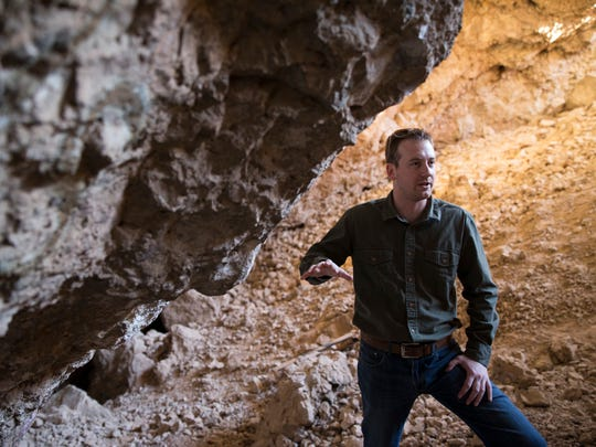 In this Tuesday, Dec. 19, 2017 photo, archaeologist Justin DeMaio speaks while touring the Gypsum Cave east of Las Vegas. A well-preserved horse skull collected more than 86 years ago from the cave near Las Vegas is helping scientists identify a new type of extinct, stilt-legged horse that died out during the last ice age. A team of researchers led by famed archaeologist Mark Harrington discovered the bone in the 1930s inside the Gypsum Cave. (Erik Verduzco/Las Vegas Review-Journal via AP)