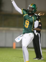 G.W. Carver's Willie Smith throws the ball to an open