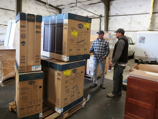 Mike Ganchenko, left, and Keldon Thompson of Northwest Human Services look at cabinetry as part of Good360 on Tuesday, March 29, 2016, at the United Way of the Mid-Willamette Valley's warehouse in Salem. Good360 is a partnership that allows the United Way to obtain retail goods from local businesses and redistribute them to nonprofit agencies in the community.