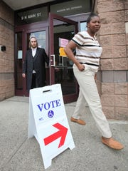 Voters exit the polling station at the Louis Kurtz