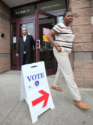 Voters exit the polling station at the Louis Kurtz Civic Center in Spring Valley during a May 2012 East Ramapo school board election. The budget originally failed, then passed on a re-vote.