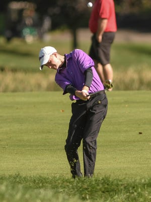 Ben Ramold of Jackson eagles the ninth hole during the Stark County Boys Golf Invitational at Glenmoor Country Club on Saturday.