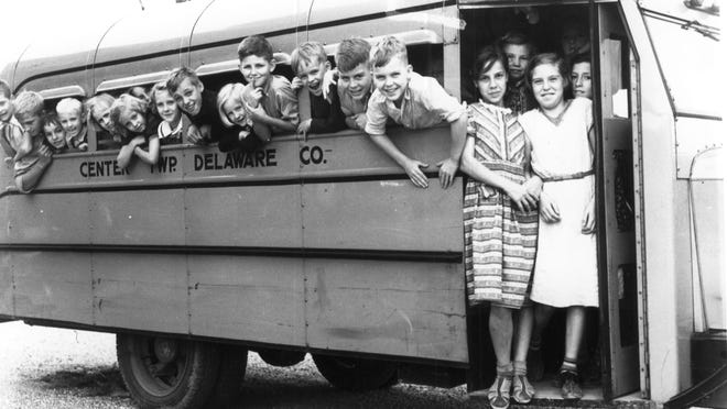 Children are shown aboard a Center Township school bus in this 1930s photograph by Richard Greene. Center Township Schools consolidated with Muncie Community Schools in 1959.
