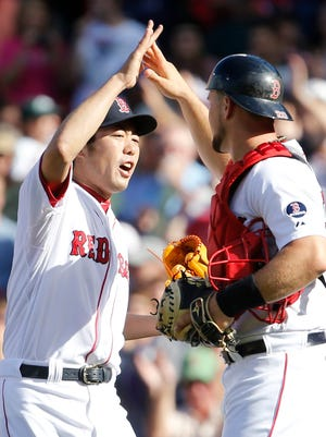 Boston Red Sox relief pitcher Koji Uehara celebrates with catcher Ryan Lavarnway after beating the Toronto Blue Jays 5-2.