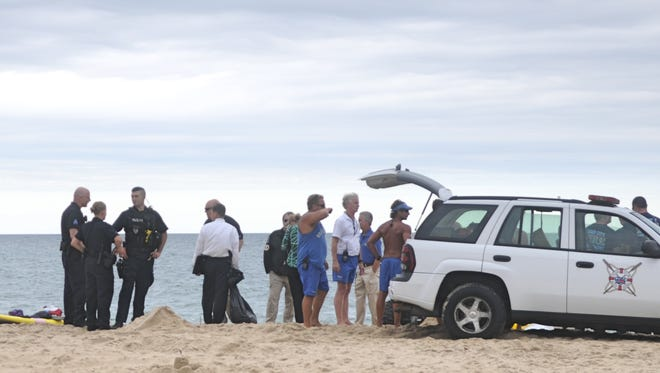 Ocean City police and Beach Patrol investigate a scene on the 127th Street beach where a male body washed ashore around 4:22 p.m.