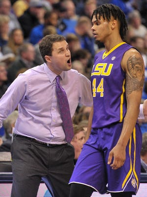 LSU head coach Will Wade and forward Wayde Sims (44) talk during the second half against Memphis.