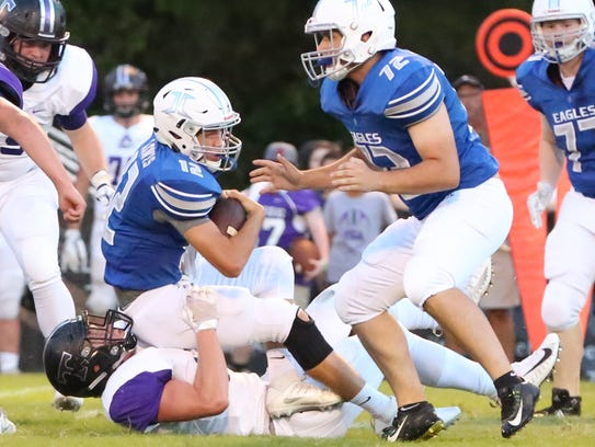Jackson Christian's Gunnar Lewis is tackled by a TCA