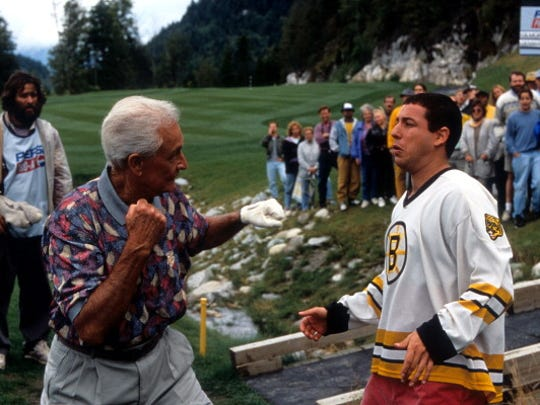 "Bob Barker prepares to punch Adam Sandler in a scene from the film ""Happy Gilmore."""