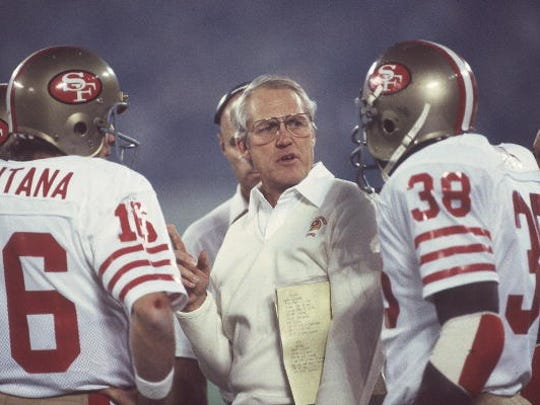 UNITED STATES - JANUARY 24:  Football: Super Bowl XVI, San Francisco 49ers coach Bill Walsh with QB Joe Montana (16) and Johnny Davis (38) on sidelines during game vs Cincinnati Bengals, Pontiac, MI 1/24/1982