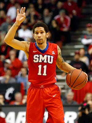 SMU guard Nic Moore (11) dribbles in a Jan. 3 game at Cincinnati, which won 56-50.