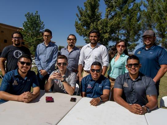 Members of the PRNR Club seated, L-R, Rigoberto Duran,