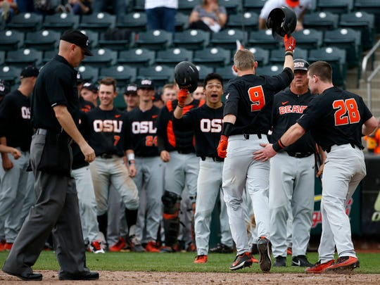 Oregon State's Andy Armstrong is congratulated by teammates after hitting a home run on the Missouri State Bears at Hammons Field on Friday, April 13, 2018.