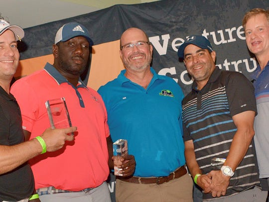 Winners in the golf tournament were, from left, Mike