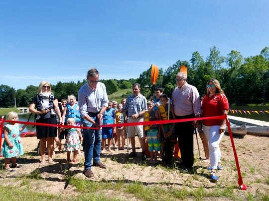 Ryan O'Reilly cuts a ribbon for the new 5-acre lake