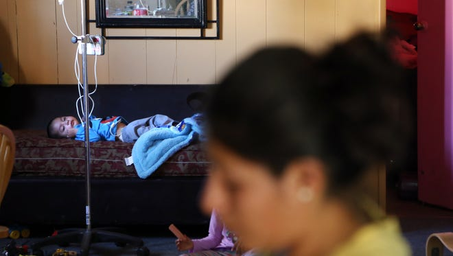Reyna Melgar's young son Josue is suffering from a debilitating disease in the Oasis Mobile Home Park in Thermal, CA,  Tuesday, January 14, 2014.