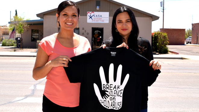From left, Mayra Solis, CASA coordinator, and Vivian Silva, volunteer coordinator, are shown holding a t-shirt the program is selling to raise funds to benefit local foster children.