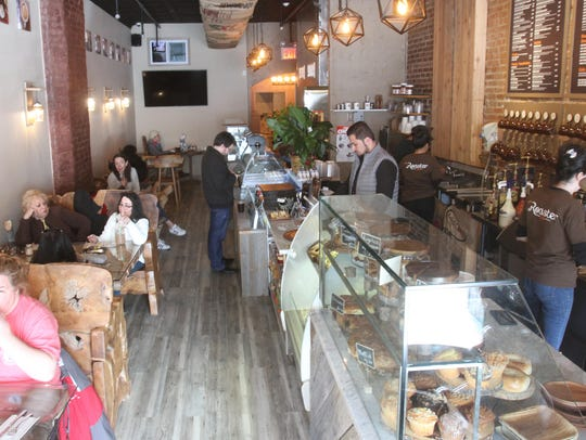 Workers are busy behind the counter at The Roaster