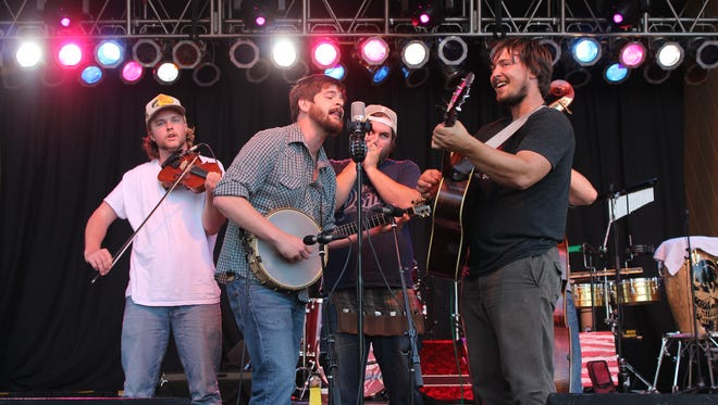Bluegrass band Horseshoes & Hand Grenades performs at the 2014 Riverfront Rendezvous.