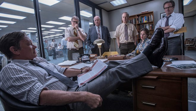 Tom Hanks as Ben Bradlee,  from left, David Cross  as Howard Simons, John Rue as Gene Patterson, Bob Odenkirk as Ben Bagdikian, Jessie Mueller as Judith Martin and Philip Casnoff as Chalmers Roberts in 'The Post.'