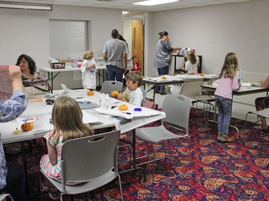 Crafters set to work on their faux pumpkin craft Oct. 3 at the Hammonton Branch of the Atalntic County Library System.