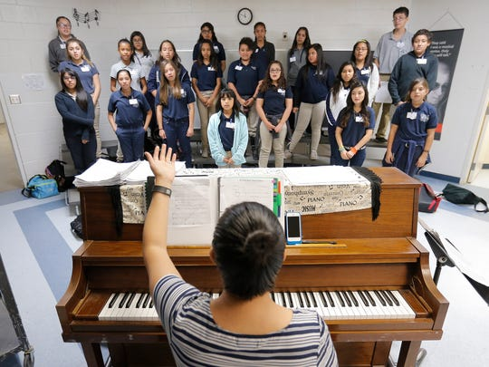 Valley View MIddle School teacher Sandra Mineros teaches both piano and choir classes in the same classroom.