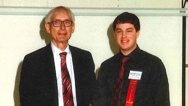 State Superintendent Tony Evers and Lincoln High School senior Zachary Kozlowski.