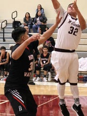 Hatch's Jason Moriel, left, tries to prevent Tularosa's Toby Carrillo from making a layup.