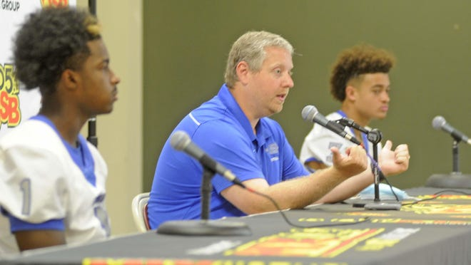 Etowah coach Ryan Locke gestures towards NyNy Davis, left, and Trent Davis, right, while answering a question at the 2020 Etowah County Football Media Day, hosted by 105.1 WQSB at the Downtown Civic Center in Gadsden on Tuesday, July 28, 2020.
