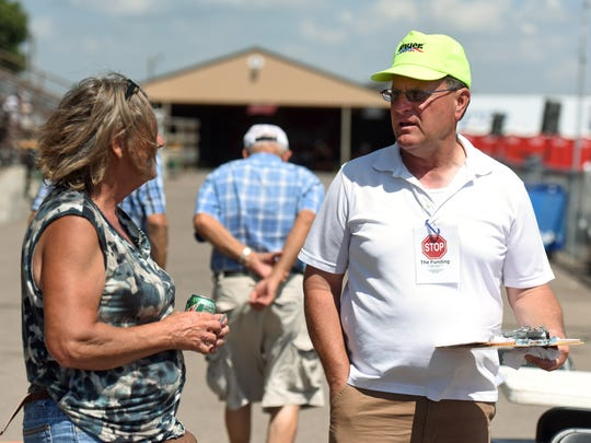 """""""Stop The Funding"""" Co-Chair Bruce Danielson (right) talks with people and gathers signatures at the W.H. Lyon Fairgrounds during the Sioux Empire Fair recently"""