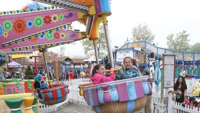 People enjoy the opening day of Playland in Rye May 9.