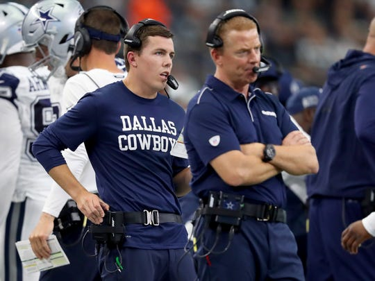 Offensive coordinator Kellen Moore of the Dallas Cowboys and head coach Jason Garrett of the Dallas Cowboys in action on the sideline against the Miami Dolphins in the second half at AT&T Stadium.