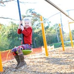 Layla Stout plays at J's Place playground, which opened in late 2014 in Lamar County.