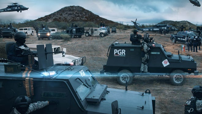 Production stills from the movie Sub Rosa released to the Standard-Times show a military movie convoy rolling past San Angelo's Twin Buttes.