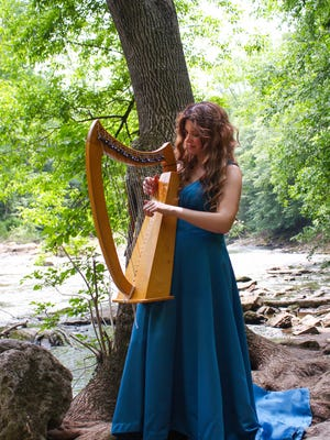 Laura Dishong, a Moorestown resident and music teacher at Mary Roberts School, is a harpist and singer, who recently released a CD.